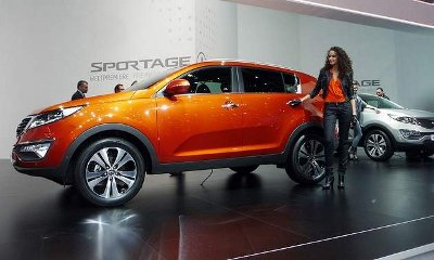The 2011 Kia Sportage breaks from tradition with aggressive styling and a color-matched auto show model